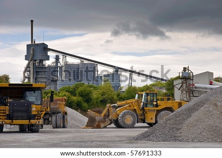 photo heavy large industrial stone quarry machinery - stock photo