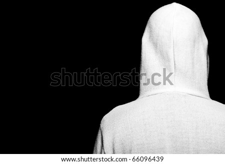 photo high contrast dark moody capture of male with hoodie on black - stock photo