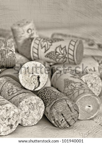 Photo illustration of wine corks with texture overlay, in sepia - stock photo