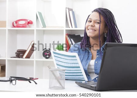 photo in house of a woman young with the computer laptop and those documents