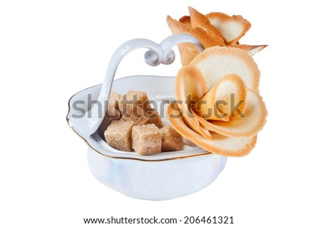 photo isolated a flower from cookies in a sugar bowl - stock photo
