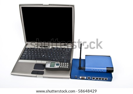 photo laptop and firewall with ethernet switch and phone on white