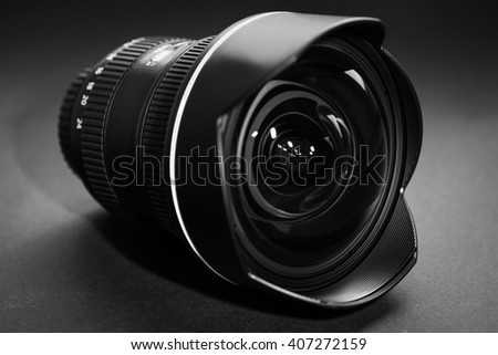 photo lens isolated on a black background