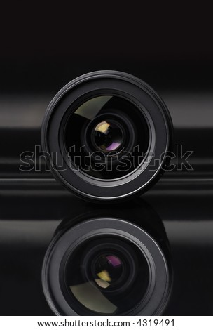 Photo lens with lens reflections on black background