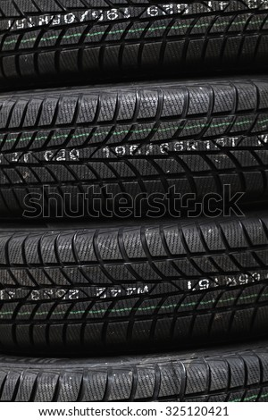 Photo lots of new black car tire  - stock photo