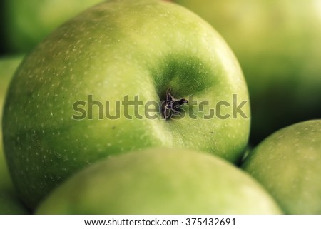 Photo macrography of big clean natural organic fresh tasty ripe green apple crop fruit full of vitamin for healthy eating diet ball form for sale on blurred background, horizontal picture - stock photo