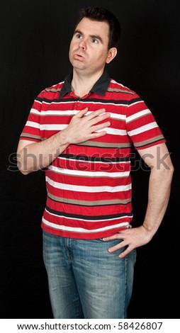 photo male having chest pain on black backdrop - stock photo