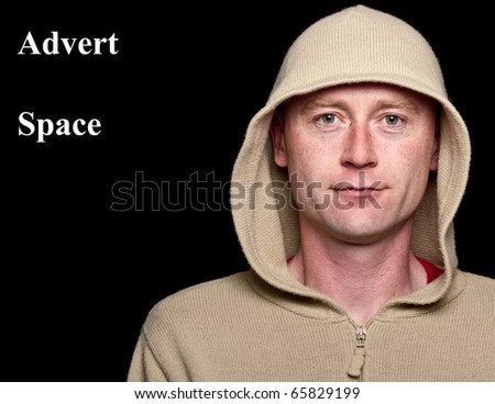 photo male in a hoodie funky clothes on black - stock photo