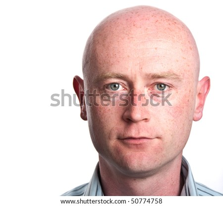photo male man portrait close up shaved bald head face eyes on white backdrop isolated.