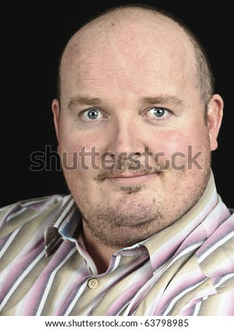 photo male portrait of man smiling on black - stock photo