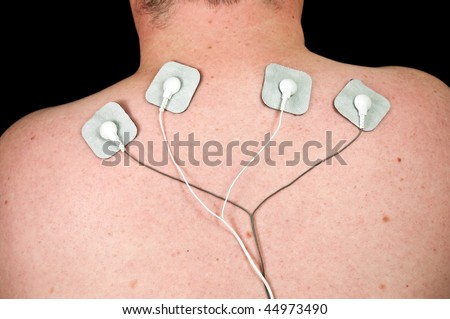 photo male with acute neck pain, electrodes to tens unit - stock photo