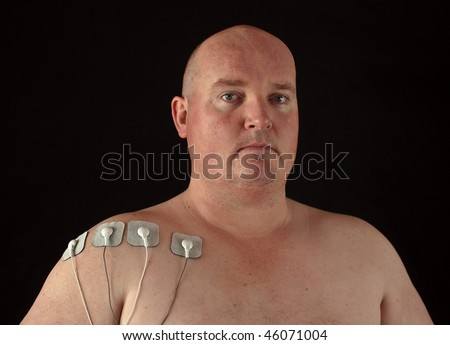 photo male with tens senors on his body for massage - stock photo
