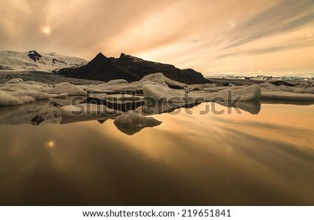 Photo midnight on the lake Jokulsarlon, Iceland - stock photo