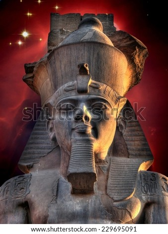Photo-montage of Ramses II Colossus at Luxor and Cone Nebula (Elements of this image furnished by NASA) - stock photo