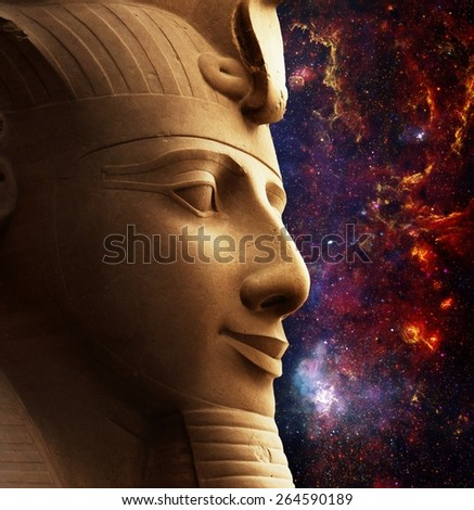 Photo-montage of Ramses II colossus face and Galactic Center Region (Elements of this image furnished by NASA) - stock photo