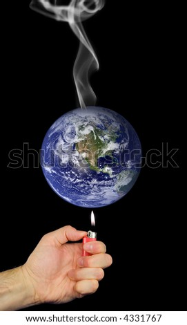 Photo montage representing global warming with lighter held to earth and smoke rising. - stock photo