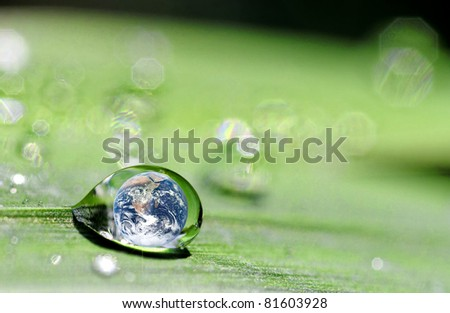 photo montage where the earth is inside a drop - stock photo