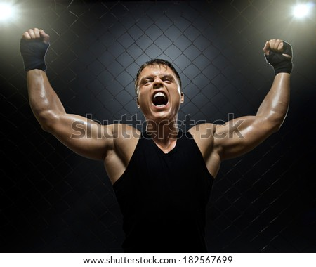 photo  muscular young  guy street-fighter,  triumphant cries  yell , hard light - stock photo
