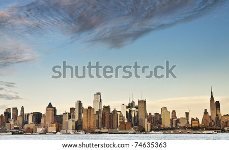 photo new york city skyline over hudson river - stock photo