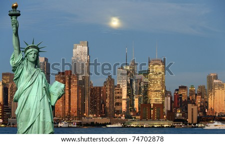 photo new york city skyline over hudson river. new york statue of liberty skyline at night. new york Manhattan skyline with moon high in sky.