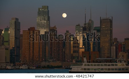 photo night time new york cityscape over hudson river
