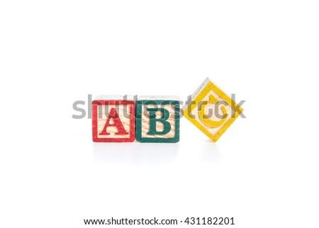 photo of a alphabet blocks spelling ABC isolate on white background - stock photo