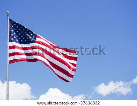 photo of a American flag on a post with cloudy background - stock photo