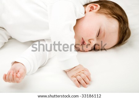 Photo of a baby, sleeping, isolated on white - stock photo