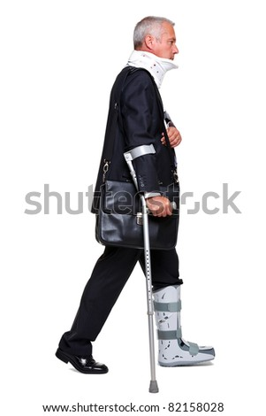 Photo of a badly injured businessman walking on cructhes carrying a briefcase, isolated on a white background. - stock photo