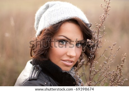 Photo of a beautiful girl in the field - stock photo