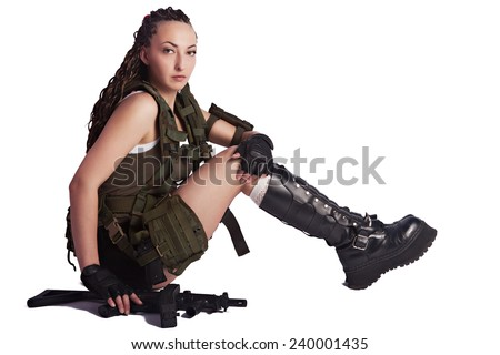 Photo of a beautiful girl in the image of a soldier on a white background - stock photo