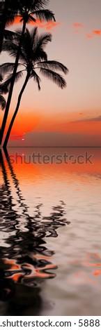photo of a beautiful orange sunset over ocean - stock photo