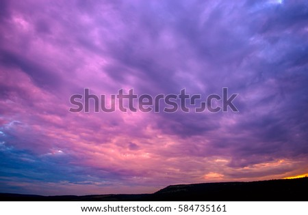 Photo of a beautiful violet sunset with clouds