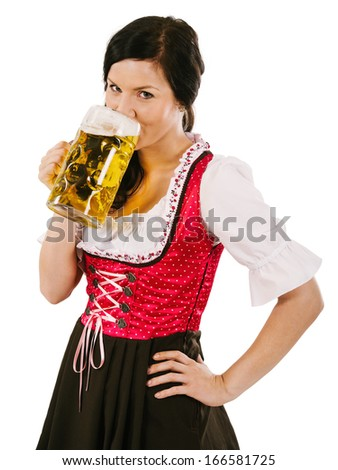 Photo of a beautiful woman wearing traditional dirndl and drinking a huge beer.
