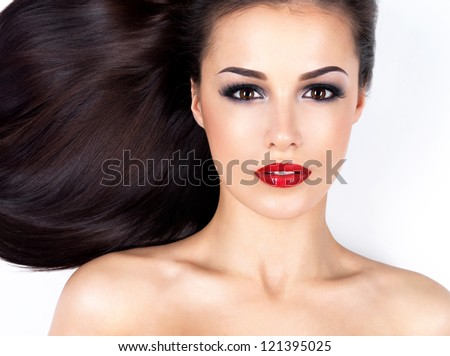 Photo of a beautiful woman with long straight brown hair looking at camera - stock photo