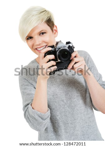 Photo of a beautiful young blond woman holding an old SLR film camera.