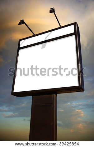 Photo of a big blank billboard against a cloudy sky at dusk - stock photo