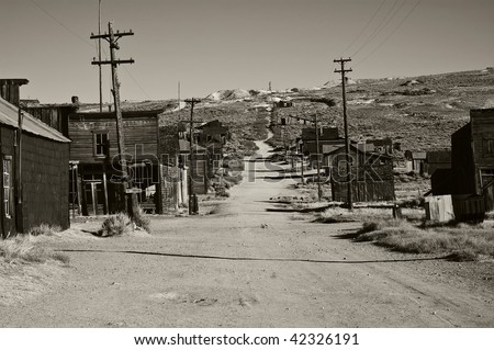 photo of a black and white old ghost town. old wild western gold rush town vintage B&W america. wild west depression in the old days. historical B&W from bodie.