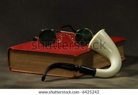 Photo of a Book with a Pipe and Glasses