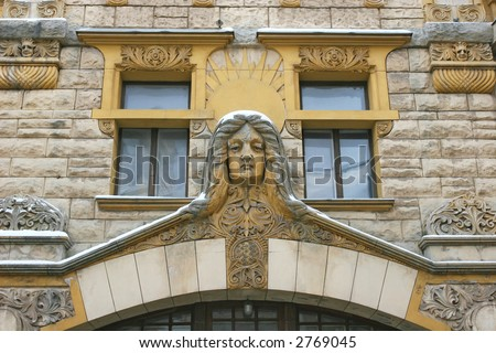 "Photo of a building facade (Riga, Latvia). This building is an example of ""Art Nouveau"" architectural style"
