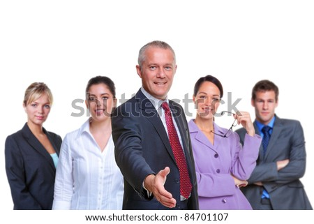 Photo of a business team, focus on the manager with his hand out in a welcoming gesture, isolated on a white background. - stock photo