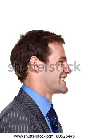 Photo of a businessman with a happy expression on his face, side headshot isolated on a white background. Part of a series.