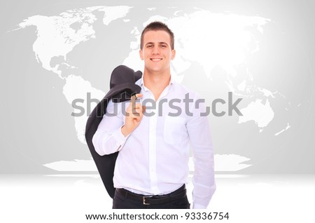 Photo of a businessman with a map of the world behind him - stock photo