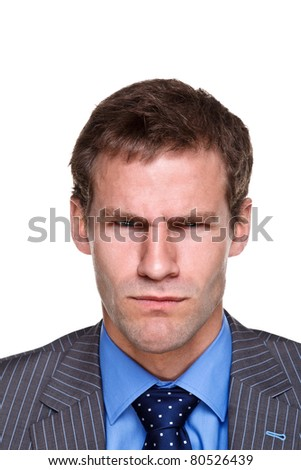 Photo of a businessman with an angry expression on his face, headshot isolated on a white background. Part of a series. - stock photo