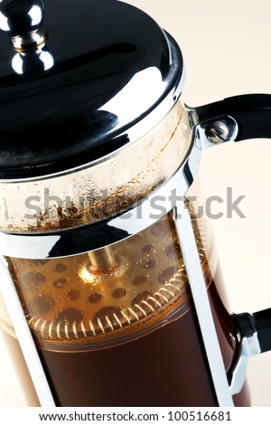 Photo of a Cafetiere with freshly brewed coffee inside, this is also know as a French press, Coffee plunger, Coffee press or Caffettiera. - stock photo
