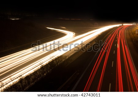 Photo of a car on the street in the night