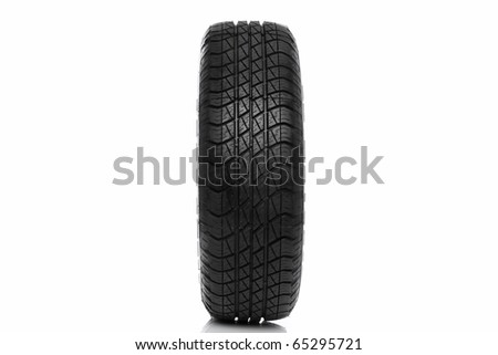 Photo of a car tyre (tire)  isolated on a white background - stock photo