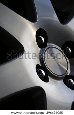 Photo of a car wheel. Close up. - stock photo