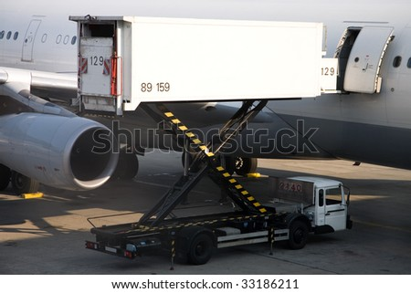 Photo of a cargo truck, loading in the plane - stock photo
