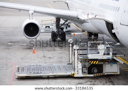 Photo of a cargo unloading process in the airport - stock photo